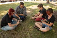 From left to right, Brooke Brei, Austin Brei, Ben Davidson, and Sarah White, play Pokemon Go and socialize at the Denton County Courthouse-on-the-Square.  The group said they have captured many Pokemon on the square such as Tauros, Pikachu, Zubat and Rattata, Friday, July 22, 2016, in Denton, Texas. Jeff Woo/DRC(DRC)