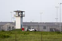 """An inmate works outdoors on the """"hoe quad"""" outside a modern-day Texas prison unit in Huntsville, Texas on Thursday, June 25, 2015. (Rose Baca/The Dallas Morning News)Staff Photographer"""