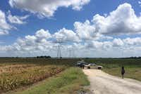 Police cars block access to the site where a hot air balloon crashed early Saturday, July 30, 2016, near Lockhart, Texas.(James Vertuno/AP)