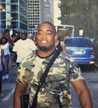 This photo was tweeted by Dallas police showing open carry activist Mark Hughes, with text describing him as a suspect in the ambush. That turned out to be erroneous; Hughes was participating in the march.(Twitter)