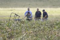 "The partial frame of a hot air balloon is visible above a crop field as investigators comb the wreckage of a crash Saturday morning, July 30, 2016, near XXX, Texas. Authorities say the accident caused a ""significant loss of life.""(Ralph Barrera/AP)"