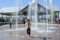 Blake Saunders, 4, runs through the fountains outside the pavilion at the Coppell Farmers Market in Coppell.(File 2014/DMN)