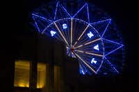 The Texas Star Ferris wheel was lit up at night during the free festival celebrating the 80th anniversary of the Texas Centennial Exposition at Fair Park on June 10.(<p>Ting Shen/The Dallas Morning News<br></p><p></p>)