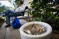 Herbert quit smoking after 45 years because he didn't want to expose Laura to the smoke. Now, where he used to light up outside their apartment, he and his wife relax and listen to music on his smartphone.(Smiley N. Pool/Staff Photographer)