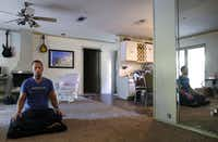 Joshua Hodnett meditates in his Hurst, Texas, home.(David Woo/Staff Photographer)
