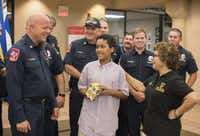 DeSoto Fire Rescue Chief Jerry Duffield, left, talks with Hector Montoya, 11, right,  for his donation of 125 smoke detectors to the department on Wednesday, Aug. 3, 2016.     (Rex C. Curry/Special Contributor)(Special Contributor)