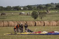 Investigators at the site where a hot air balloon crashed, killing 16 people, west of Lockhart, Texas, July 30, 2016. Officials said the craft caught fire in midair and plummeted to the ground in what appeared to be the worst balloon accident in U.S. history. (Tamir Kalifa/The New York Times)(NYT)
