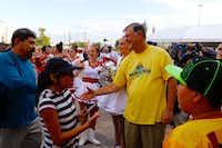 Dallas Mayor Mike Rawlings greets families at the 20th annual school supplies fair. (David Woo/Staff Photographer)