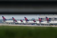 Delta planes were parked at gates at Atlanta's Hartsfield International Airport on Monday when the carrier grounded all flights after after a power outage hit its computer systems globally. (AP Photo/Branden Camp)