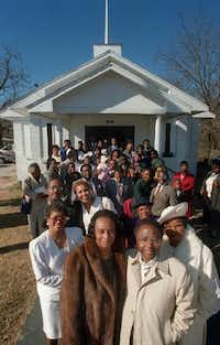 Jean Hunter (front left) gave Rev.  Earnest Freeney (front right) and the Dixon Circle Missionary  Baptist Church $22,000 to pave the parking lot in 1996. (File photo/Staff)