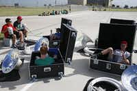 "<p>Band members get some shade in instrument boxes during marching band practice at Lebanon Trail High <a name=""firsthit"" id=""firsthit""></a>School.</p>(Nathan Hunsinger/Staff Photographer)"