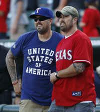 Marcus (left) and Morgan Luttrell before throwing the first pitch before a game between the Texas Rangers and New York Yankees at Globe Life Park in Arlington on July 27, 2015. (Vernon Bryant/Staff Photographer)