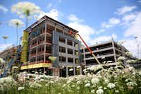 The construction of Legacy West urban village in May continues the buildup along Legacy Drive in Plano.(Rose Baca/Staff Photographer)