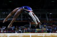 "Simone Biles of the United States competes on the balance beam during the Women's Individual All Around Final on Day 6 of the 2016 Rio Olympics at Rio Olympic Arena on August 11, 2016 in Rio de Janeiro, Brazil.(<p><span style=""font-size: 1em; line-height: 1.364; background-color: transparent;"">Photo by Elsa/Getty Images</span></p>)"