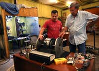 Brad Hunstable (left) and his father, Fred, go over the fine points of one of the their electric motor prototypes. Their company, Linear Labs, began as a father-son project to increase the efficiency of electric motors that could be used in automobiles, ceiling fans or drones.(Rose Baca/The Dallas Morning News)