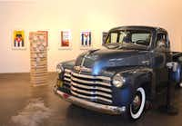 "The Erin Cluley Gallery's show """"El Mercado"""" featured a vintage pickup truck and Cuban movie posters. Cluley's gallery was one of several local galleries whose named surfaced in the controversy.(Erin Cluley Galery)"
