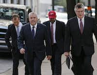 Marc Rylander (second from left), spokesman for Texas Attorney General Ken Paxton, and lawyers representing the state of Texas headed to the hearing Friday.(Nathan Hunsinger/Staff Photographer)