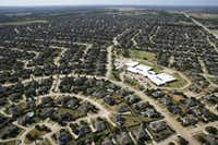 Murphy is one of several Collin County cities that have seen their populations swell in recent years — but it's also one of many suburbs that aren't members of a public transit agency.(Vernon Bryant/Staff Photographer)