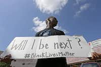 "Niamke Ledbetter, of Oak Cliff holds a sign at a Black Lives Matter protest on Park Lane in Dallas on July 10, 2016.&nbsp;(<p><span style=""font-size: 1em; line-height: 1.364; background-color: transparent;"">Jae S. Lee/Staff Photographer</span></p>)"