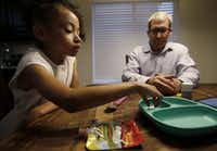 "<span style=""font-weight: normal;"">Riley Kinman, 5, takes a pill as her father, Terry Kinman, looks on at their home in Little Elm, Texas, Friday, Aug. 12, 2016. Children's Health uses ingestible sensors to track medication adherence in a group of 75 children with liver and kidney transplants.  (Jae S. Lee/The Dallas Morning News)</span>(Staff Photographer)"