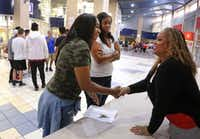 Tia Simmons (right)  visits with staff at Duncanville HIgh School one week before the start of a new school year.(Louis DeLuca/Staff Photographer)