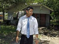 Community prosecutor Robert Abtahi looks at the code compliance progress along Alabama Avenue in Dallas on Tuesday, June 28, 2011.(Louis DeLuca/The Dallas Morning News)