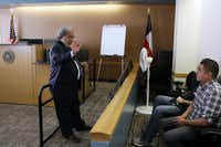 Judge Daniel Solis speaks with two Spanish speakers explaining the process of the court system, on Thursday, Feb. 20, 2014 at the Dallas municipal court in Downtown Dallas.(Ben Torres/Special Contributor)