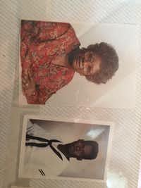Photos of Manuella Moore and her son Edward Adkins in Adkins' photo album.(Tristan Hallman/Staff)