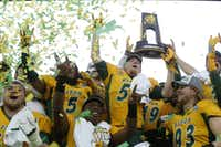 The North Dakota State Bison celebrate a win in January in the FCS Championship Game at Toyota Stadium in Frisco.(Nathan Hunsinger/Staff Photographer)