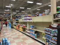 Some shelves are emptying out, but there's still a lot of food and merchandise inside the Sun Fresh Market at 10203 E. Northwest Highway.(Maria Halkias/Staff)