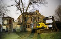 And this is what the house looked like as recently as January, when Time Warner had demolition crews ready to raze the structure to make room for a new hub facility.(Tom Fox/Staff Photographer)