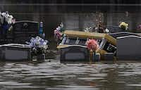 A casket is seen in a flooded cemetery on Aug. 17, 2016, in Sorrento, La. Tremendous downpours have resulted in disastrous flooding, responsible for at least 13 deaths and thousands of homes being damaged.Joe Raedle/Getty Images