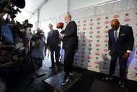"""Former Dallas Cowboys Roger Staubach and Drew Pearson re-create, in concrete, the 50-yard """"Hail Mary"""" pass that won the 1975 playoff game against the Minnesota Vikings.(Vernon Bryant/Staff Photographer)"""