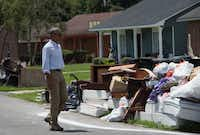 President Barack Obama walked past piles of ruined possessions that residents have placed outside their homes in Baton Rouge. (Nicholas Kamm/Agence France-Presse)