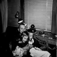 Larry Whitford with daughter Nancy, 5, and son Larry Jr., 6, in February 1963. Whitford's F-100 Super Sabre crashed Nov. 2, 1969, in Laos during the Vietnam War.((Nancy Eger))