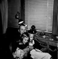 Larry Whitford with daughter Nancy, 5, and son Larry Jr., 6, in February 1963. Whitford's F-100 Super Sabre crashed Nov. 2, 1969, in Laos during the Vietnam War. ((Nancy Eger))