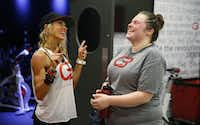 Anja Taylor shares a laugh with Lynn Marsh, her cycle coach, after working out at CycleBar in Flower Mound.(Nathan Hunsinger/Staff Photographer)