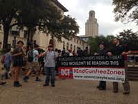 <p>Gun-rights advocates from Open Carry Texas, including leader C.J. Grisham (left), were in the minority at Wednesday's protest at UT.</p>(<p>Tom Benning/Staff</p><p></p>)