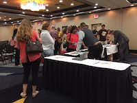 At the end, buyers lined up to ask questions and purchase more learning packages.