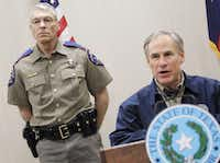 Texas DPS Director Steve McCraw, with Gov. Greg Abbott, will probably have to work to get some lawmakers past the sticker shock of the agency's budget request.(2015 File Photo/The Associated Press)
