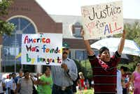 Protesters marched in front of Farmers Branch City Hall in 2006 to protest ordinances dealing with immigration. (File Photo/The Associated Press)