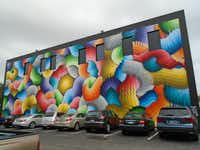 Ricky Watts used 500 cans of spray paint to hand-paint Space Rainbows, a giant mural in downtown St. Pete. Robin Soslow