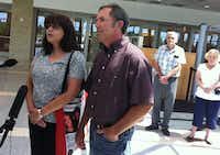 Parents Anna and Mark Morris answer questions from the media after a June hearing at the Collin County Courthouse. Behind them are Christina Morris' grandparents, David and Linda Morris.(File photo)