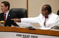 Dallas County Judge Clay Jenkins (left) and Commissioner John Wiley Price. Price is facing a federal corruption trial in February.(David Woo/Staff Photographer)