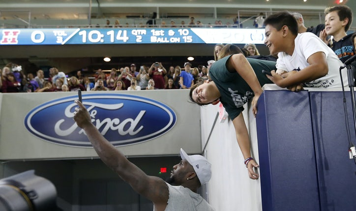 Dallas Cowboys wide receiver Dez Bryant (88) takes photos with fans during  a game between Lone Star High School and Heritage High School at The Star  in ... 8b7dfb9b2