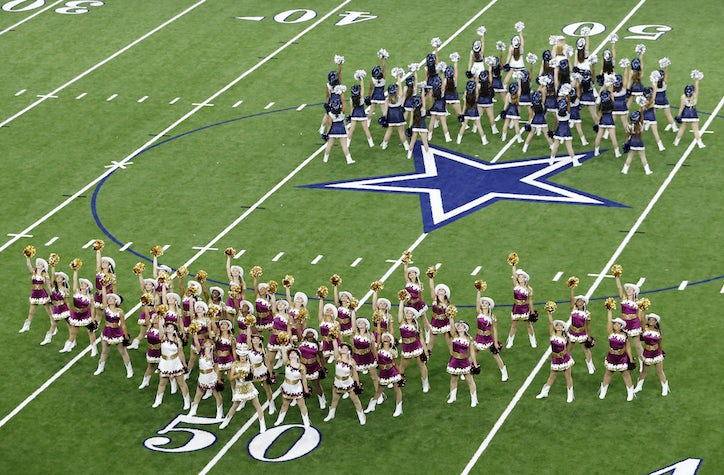 Heritage High School and Lone Star High School perform simultaneously  during halftime during the second of four games played at The Star in Frisco  on ... ecd3a1a87