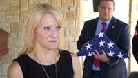Tiffany McCullers talks to reporters at the burial for her husband, SMU Officer Mark McCullers, on Monday in Dallas.(KXAS-TV(NBC5))