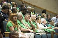 People opposed to Walt Humann's plan wore green shirts to the council meeting Monday.(Rex Curry/Special Contributor)