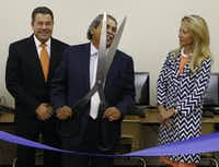 Juan Fontanes (left), CIO of NEC, DISD superintendent Michael Hinojosa and and Lynn McBee, CEO of the Young Women's Preparatory Network, took part in a ribbon cutting and unveiling of the new computer lab at Irma Rangel Young Women's Leadership School on Tuesday. <div><br></div>(David Woo/Staff Photographer)