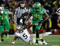 "Linebacker Tony Washington #91 of the Oregon Ducks goes to recover a fumble by quarterback Jameis Winston #5 of the Florida State Seminoles for a 58-yard touchdown in the third quarter of the College Football Playoff Semifinal at the Rose Bowl Game on January 1, 2015 in Pasadena, California. (<p><span style=""font-size: 1em; line-height: 1.364; background-color: transparent;"">Ezra Shaw/Getty Images</span></p>)"